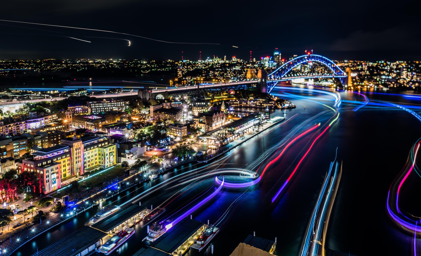 Sydney Harbour lights up from 6pm each evening during Vivid